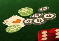Pair of aces with a dice and bitcoin chips